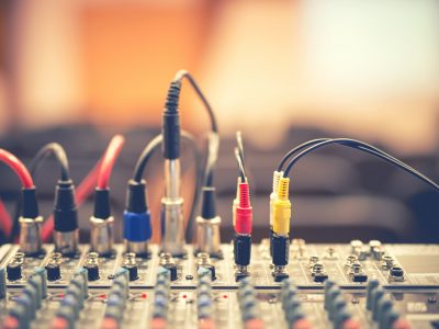 audio jack and wires connected to audio mixer, music dj equipment